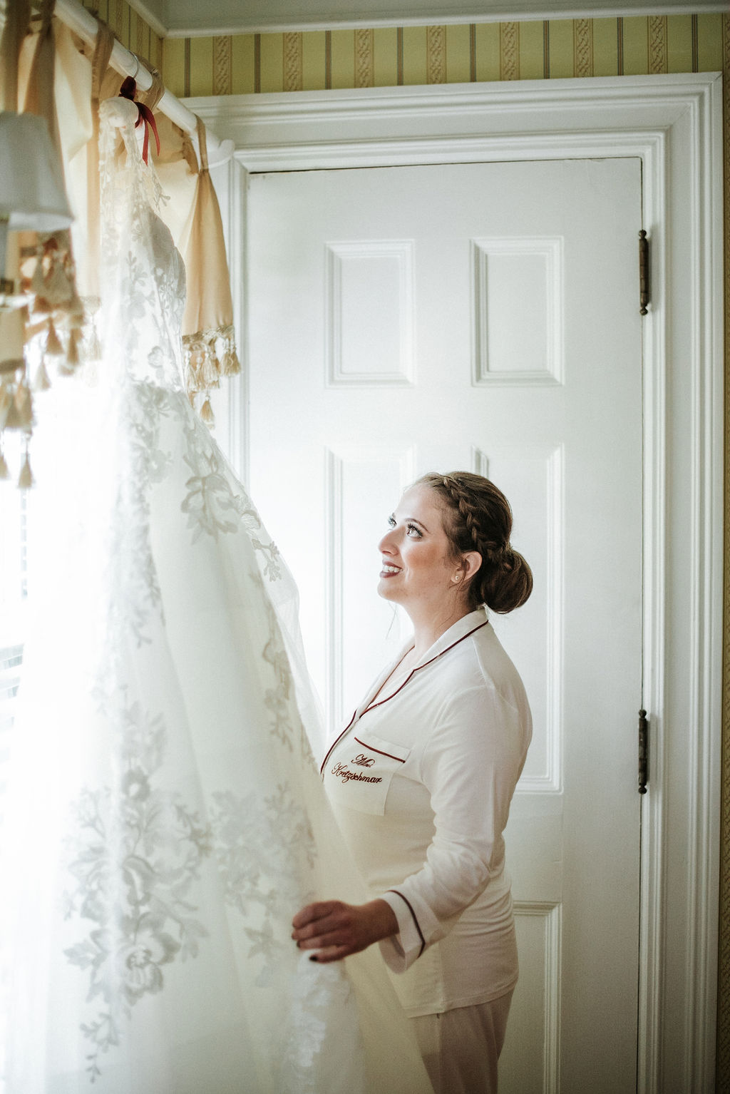 Bride admiring her wedding dress at Historic Rosemont Manor