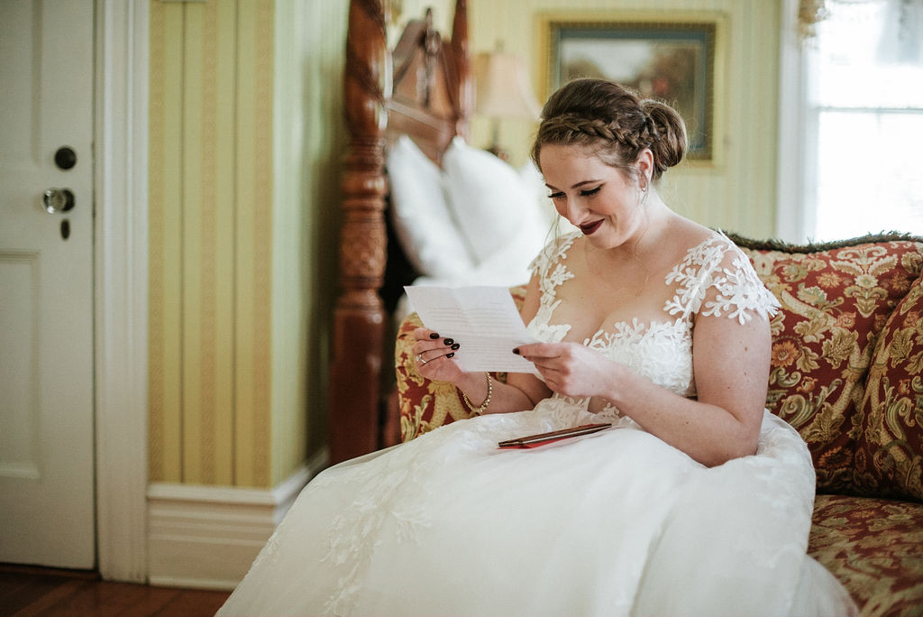 bride reading letter from groom at Historic Rosemont Manor