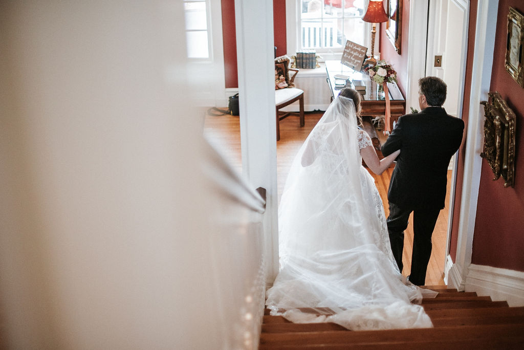 Bride walking down stairs at Historic Rosemont Manor