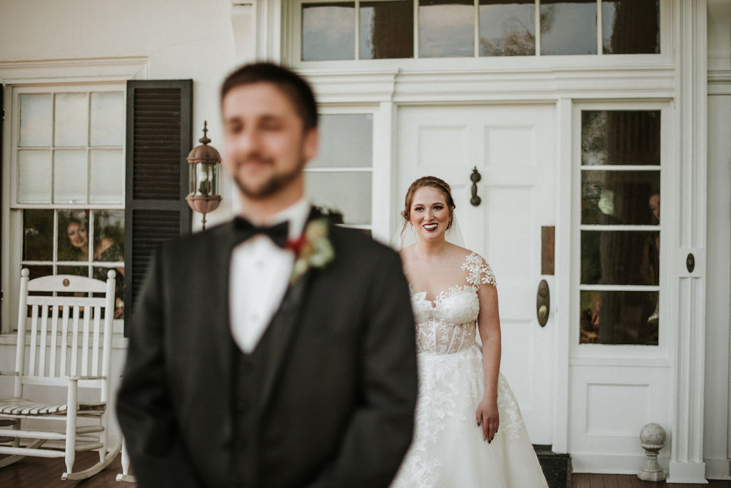 bride and groom first look at Historic Rosemont Manor