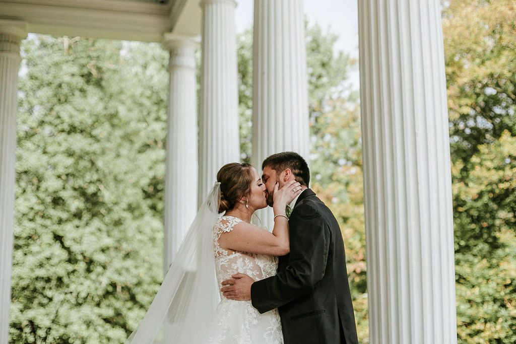 bride and groom kissing at Historic Rosemont Manor