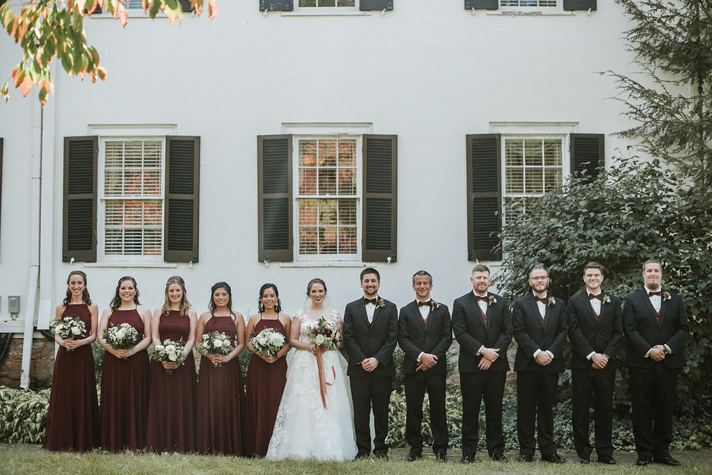 wedding party posing and smiling at Historic Rosemont Manor