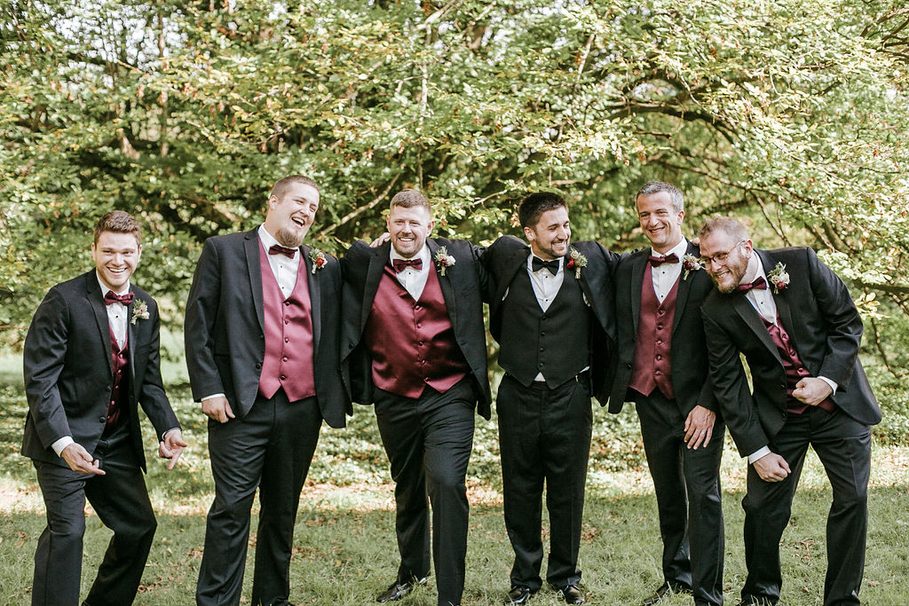 groomsmen having a good time and smiling at Historic Rosemont Manor