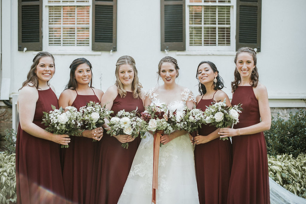bride and bridesmaids smiling at Historic Rosemont Manor