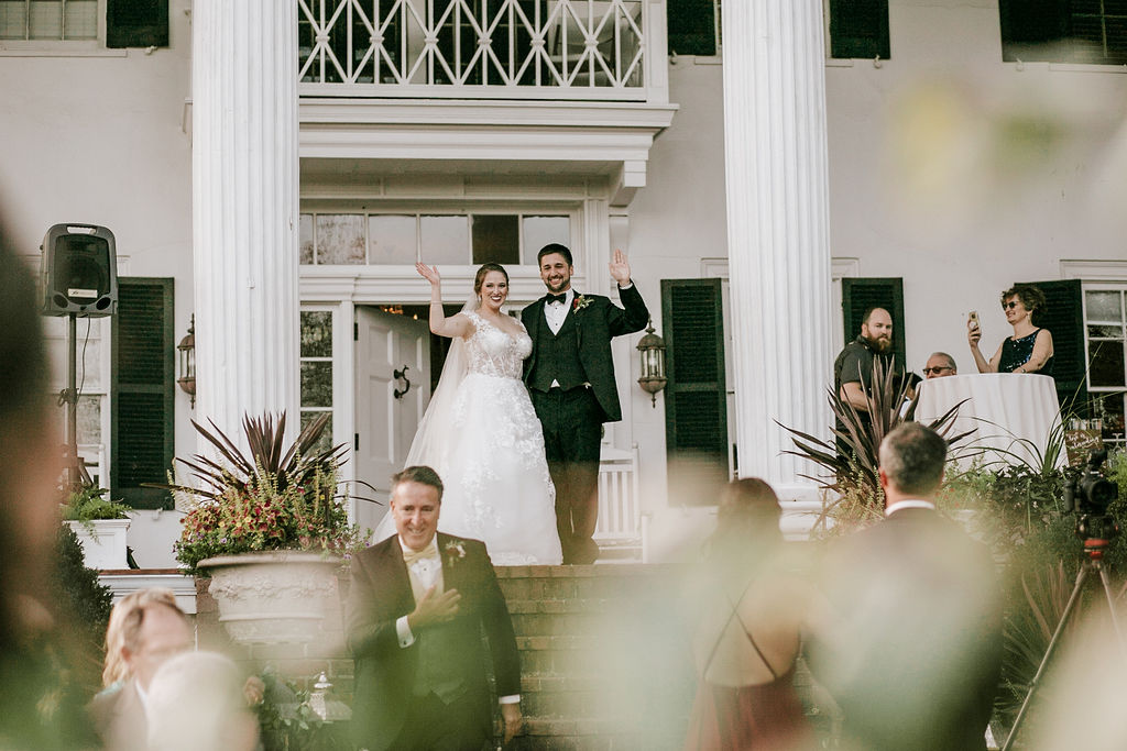 bride and groom waving at their guests at Historic Rosemont Manor