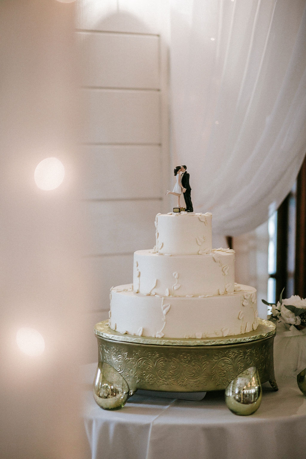 wedding cake with a cute wedding cake topper at Historic Rosemont Manor
