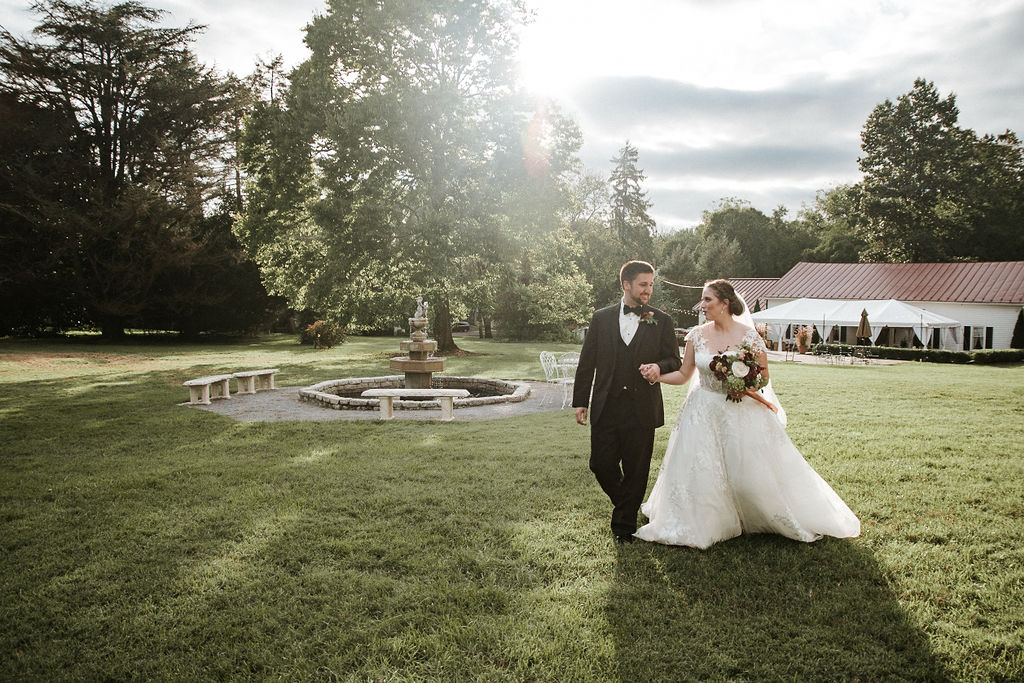 bride and groom walking around the grounds at Historic Rosemont Manor