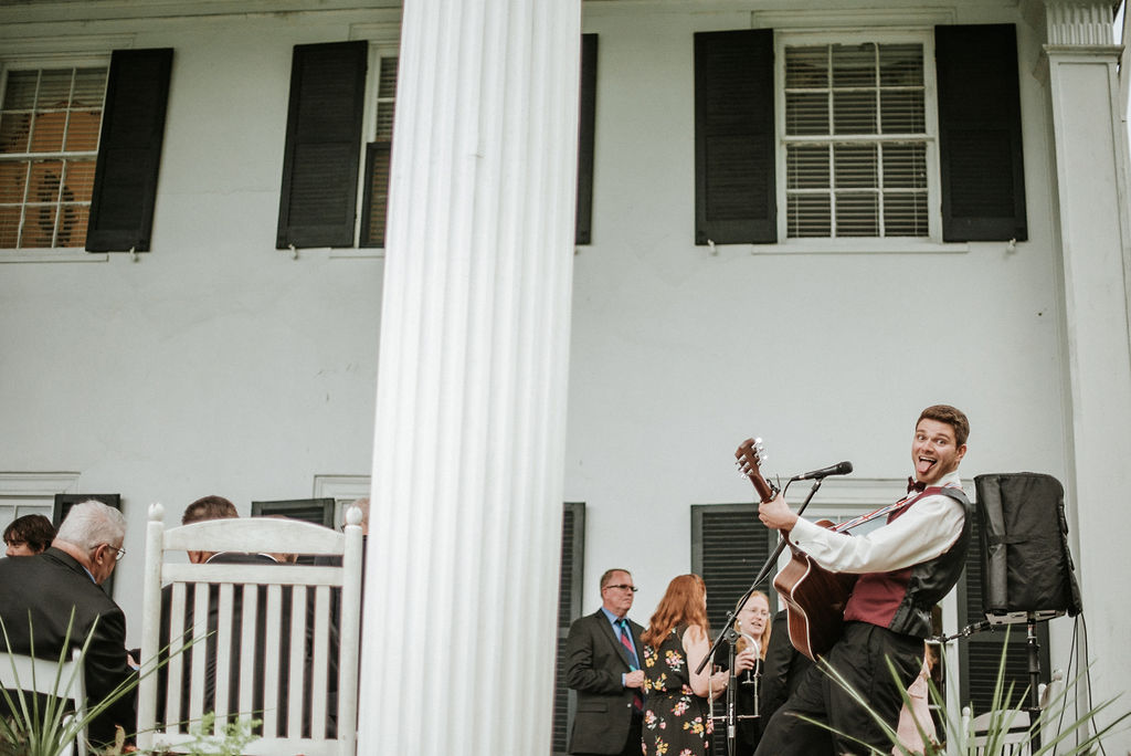 groomsmen and entertainer playing guitar and singing at Historic Rosemont Manor
