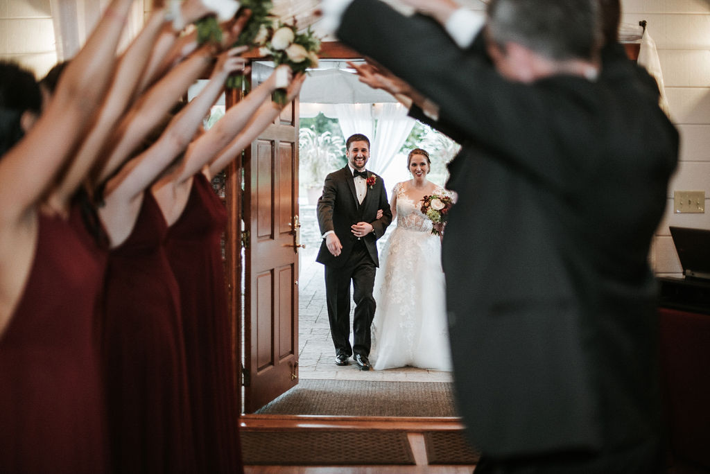 bride and groom entering the reception at Historic Rosemont Manor