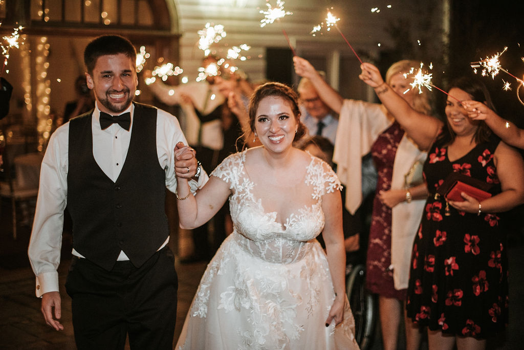 bride and groom exiting the wedding under sparklers at Historic Rosemont Manor