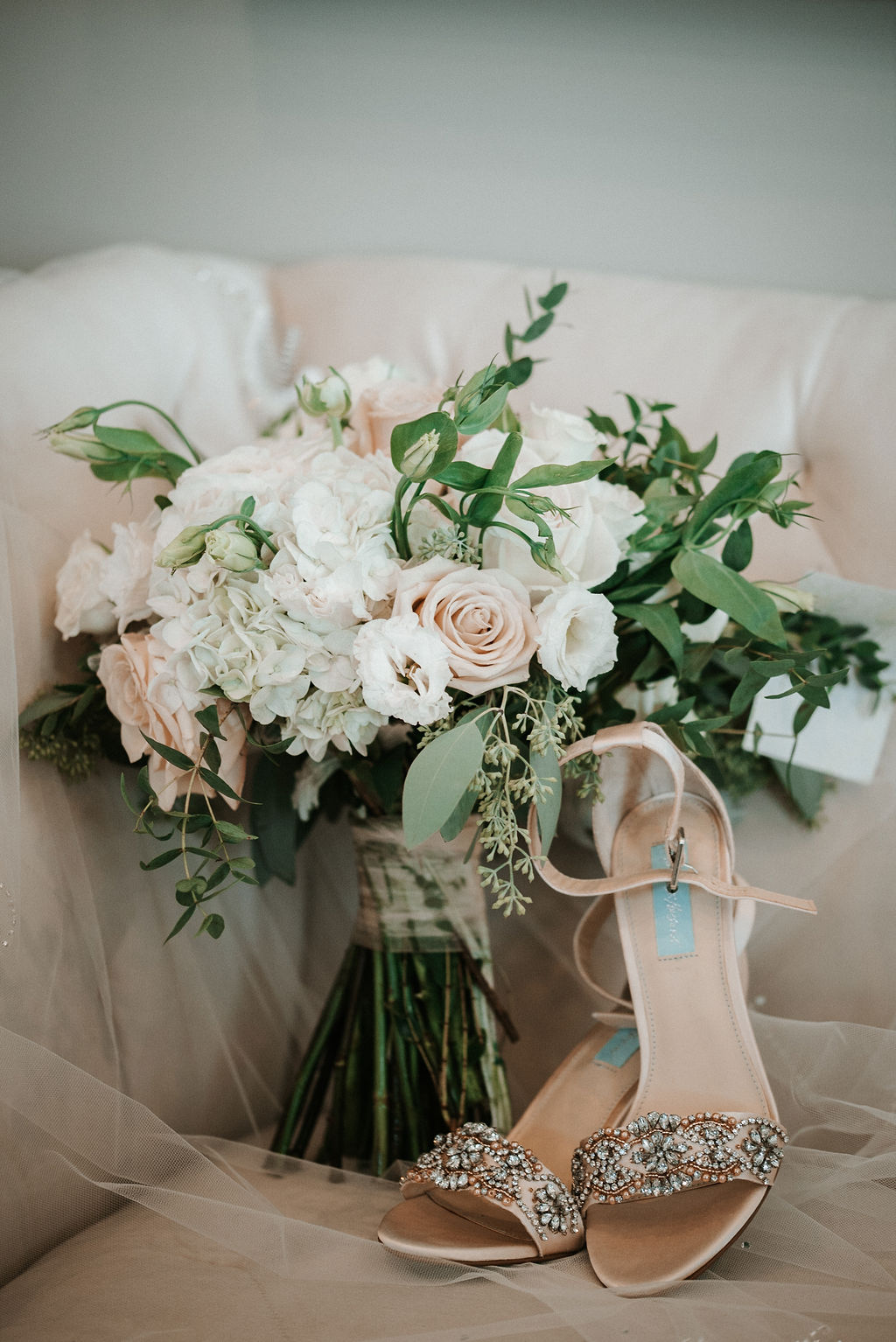 Detail Shot of Bride's Bouquet and Wedding Shoes