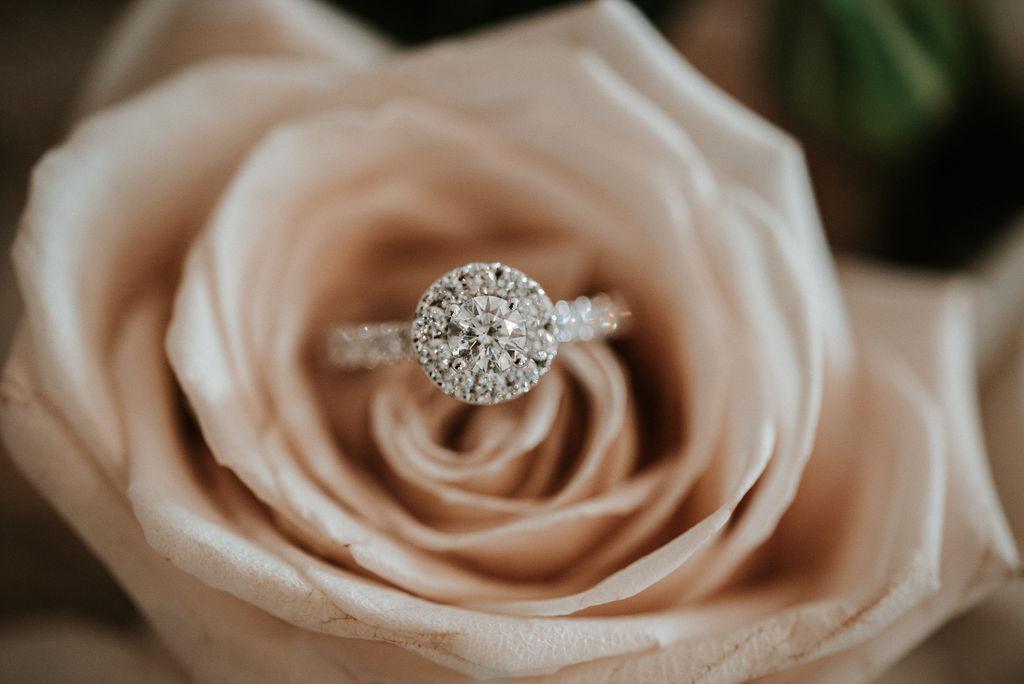 Detail Shot of Wedding Ring inside Rose at Blue Valley Vineyard