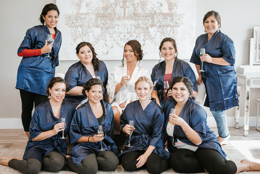 Bride and Bridesmaids drinking champagne at Blue Valley Vineyard