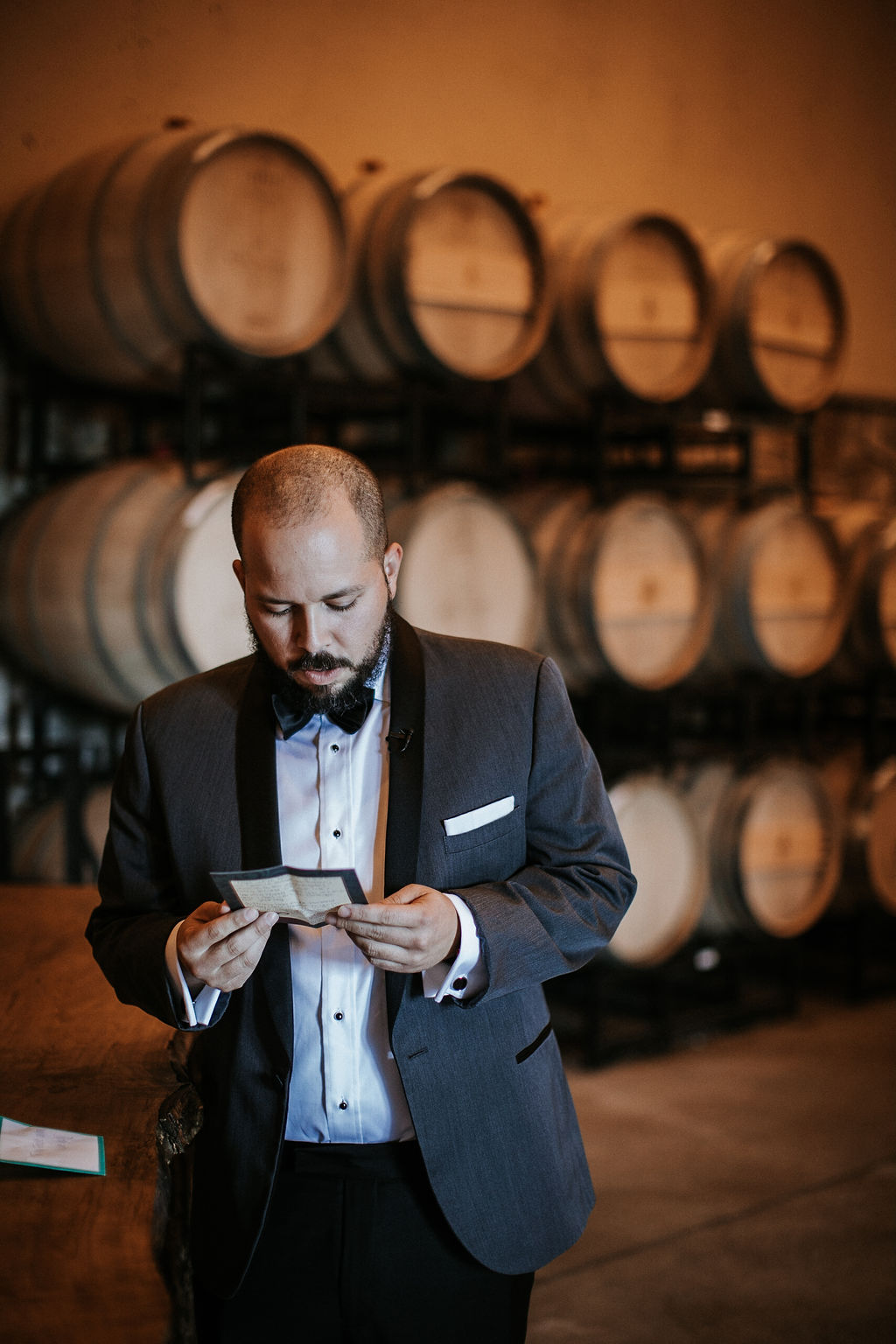 Groom Reading Letter from Bride at Blue Valley Vineyard