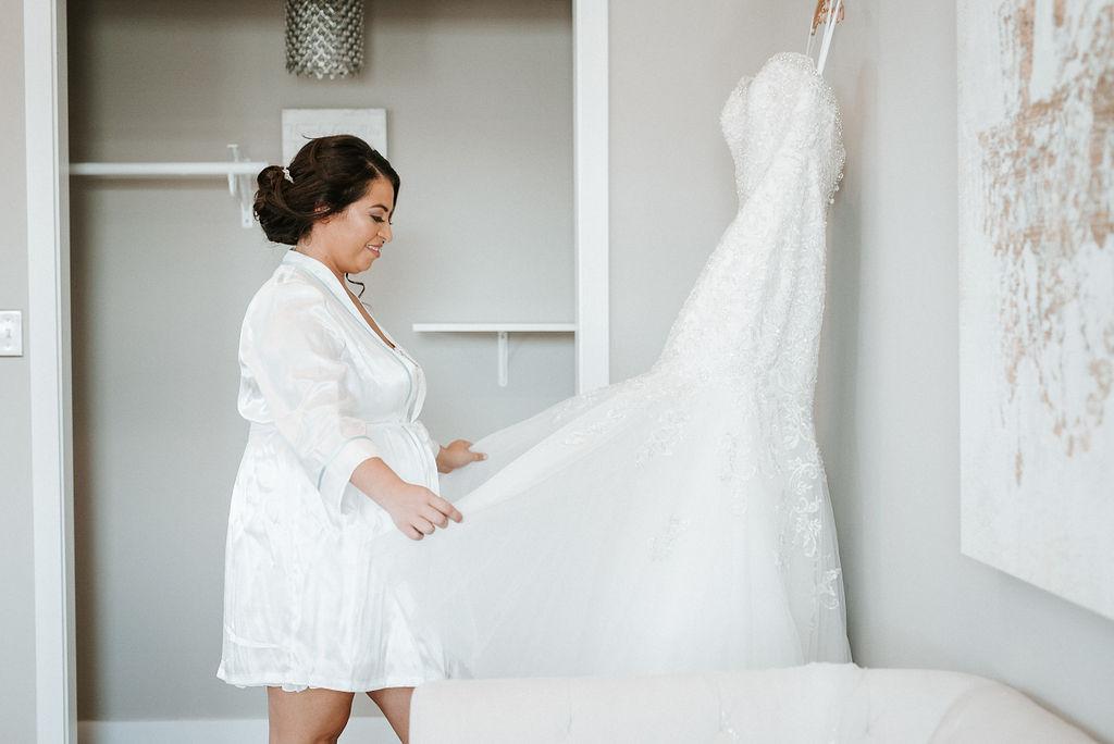 Bride looking at Wedding Dress at Blue Valley Vineyard