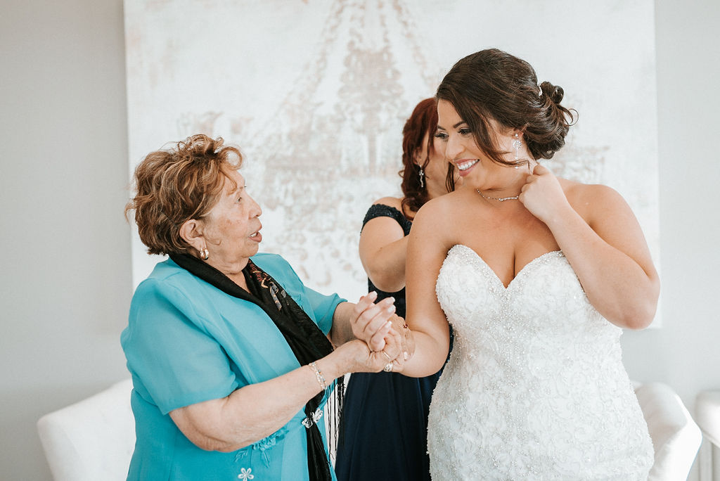 Bride's family helping her get ready at Blue Valley Vineyard