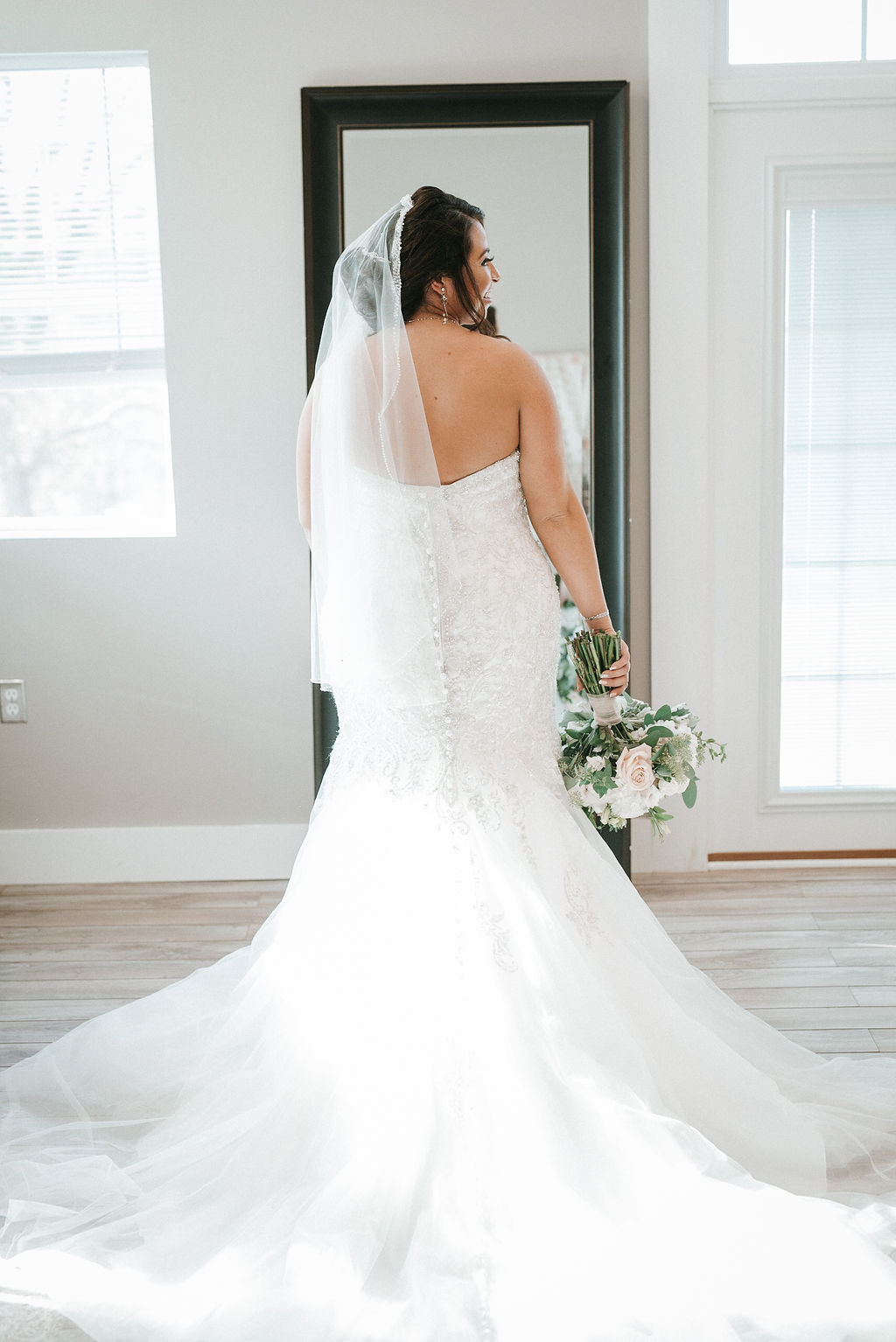The Back of the Bride in her Wedding dress at Blue Valley Vineyard