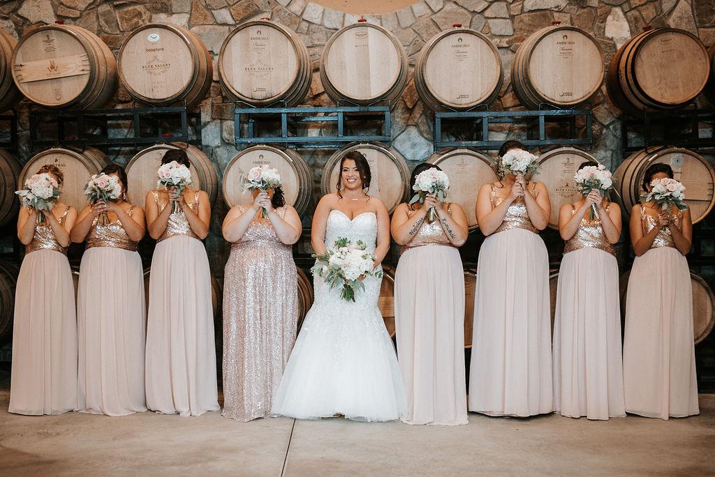 bride and her bridesmaids posing at Blue Valley Vineyard