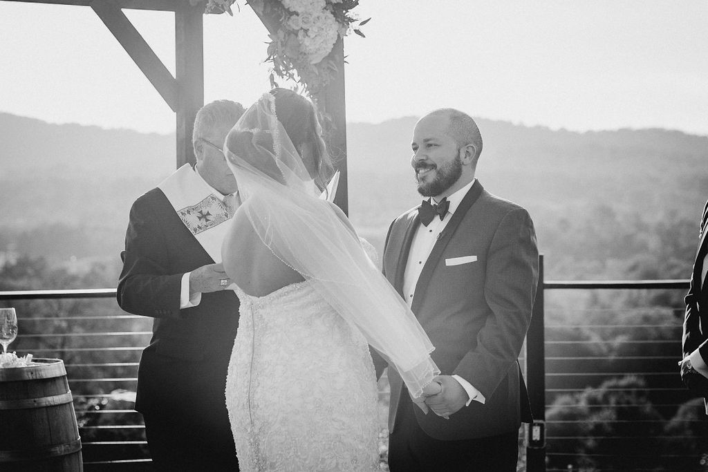 Bride and Groom holding hands at Blue Valley Vineyard