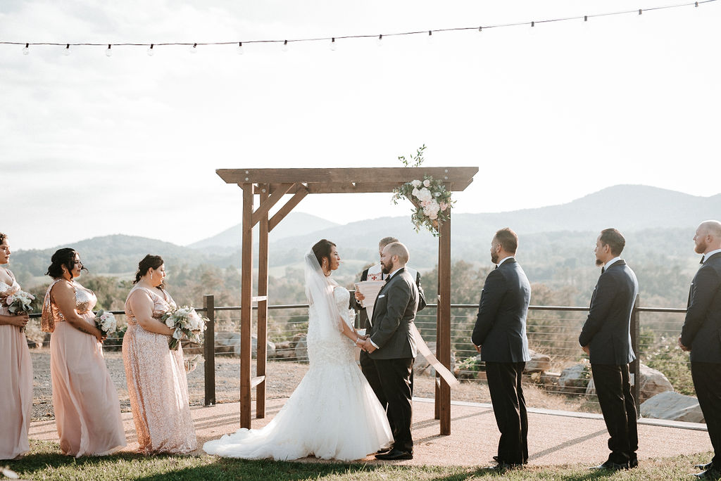 Bride and Groom holding hands at the alter at Blue Valley Vineyard