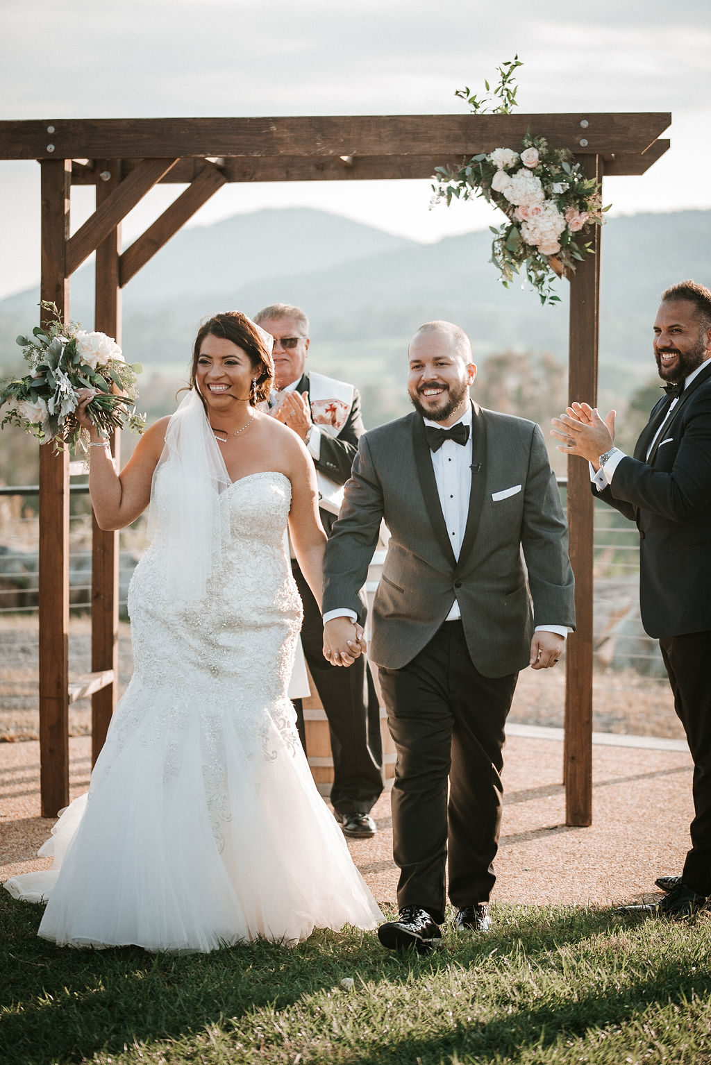 bride and groom smiling as newly-weds at Blue Valley Vineyard