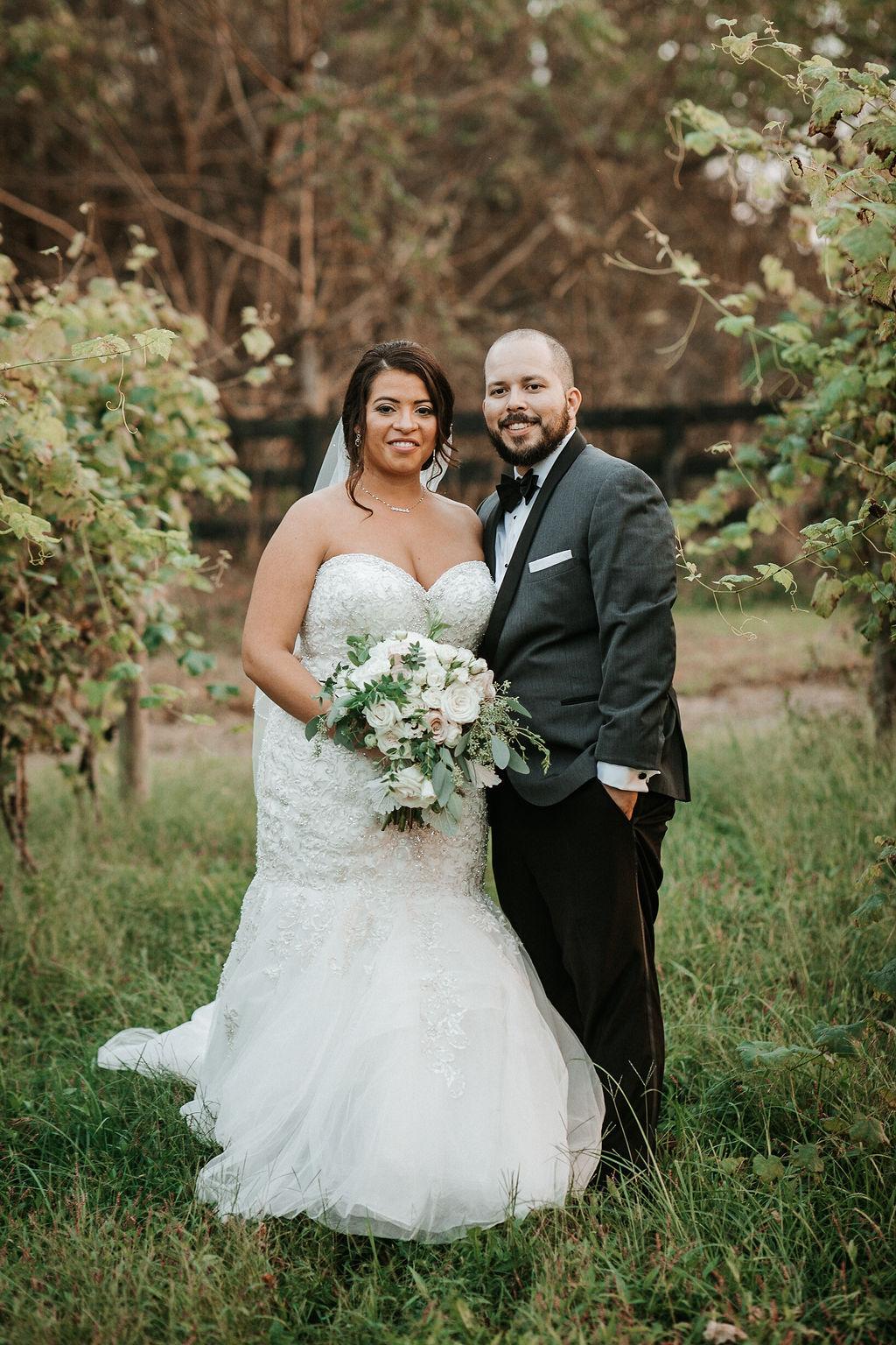 Bride and Groom Smiling in the Vineyards at Blue Valley Vineyard