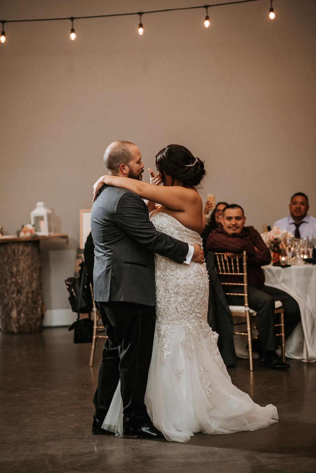 Bride and Groom dancing at reception at Blue Valley Vineyard