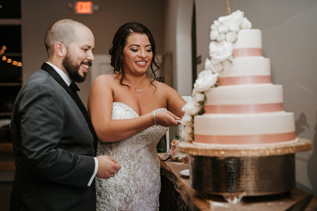 Bride and Groom Cutting the Wedding Cake at Blue Valley Vineyard