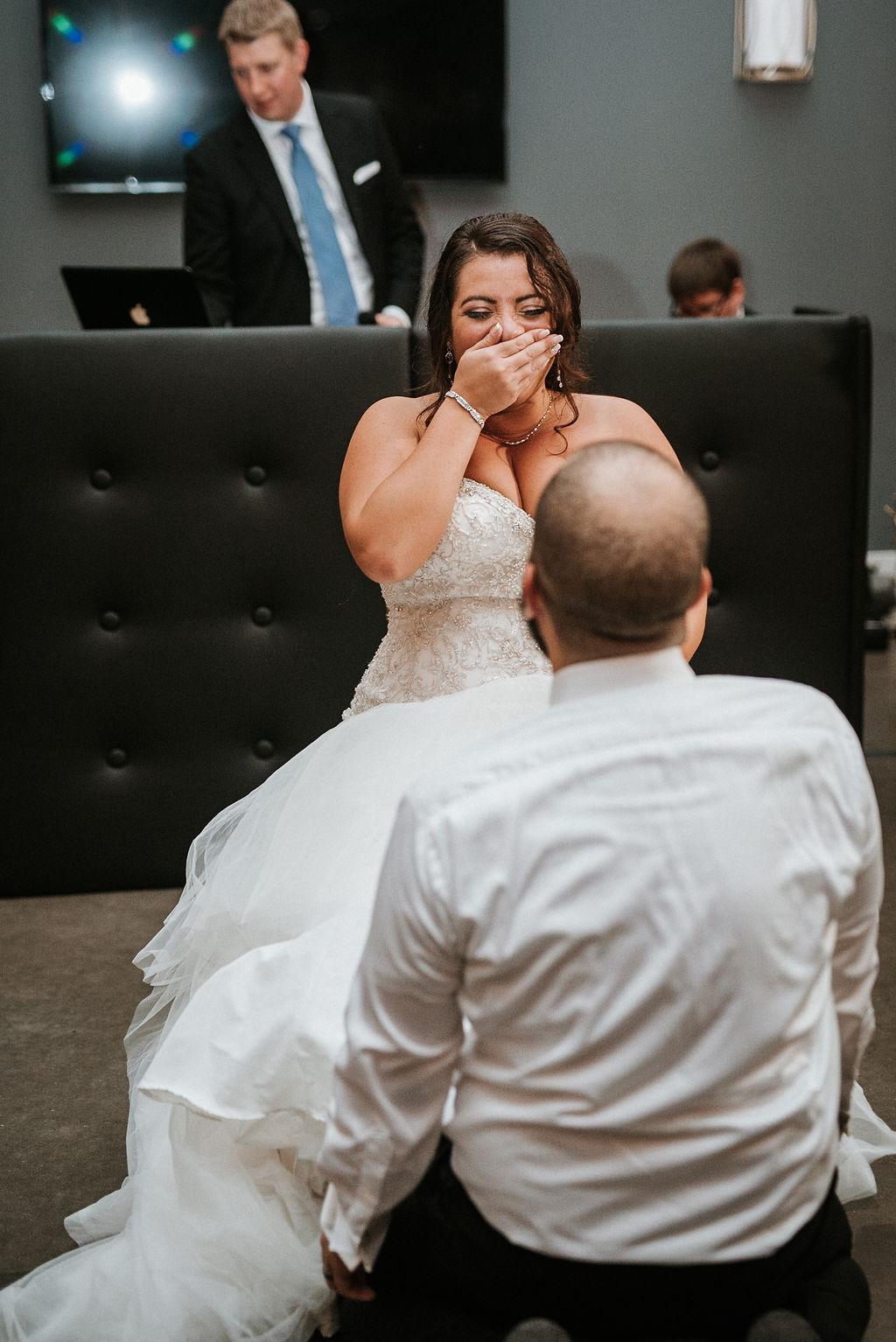 Groom Removing Bride's Garter