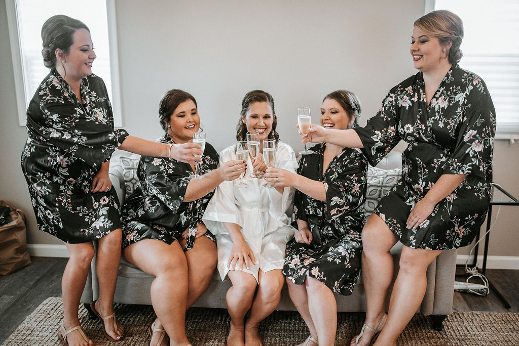 Bride and Bridesmaids drinking champagne at 48 Fields Farm