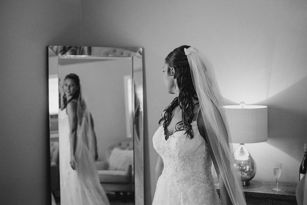 bride looking at herself in mirror at 48 Fields Farm