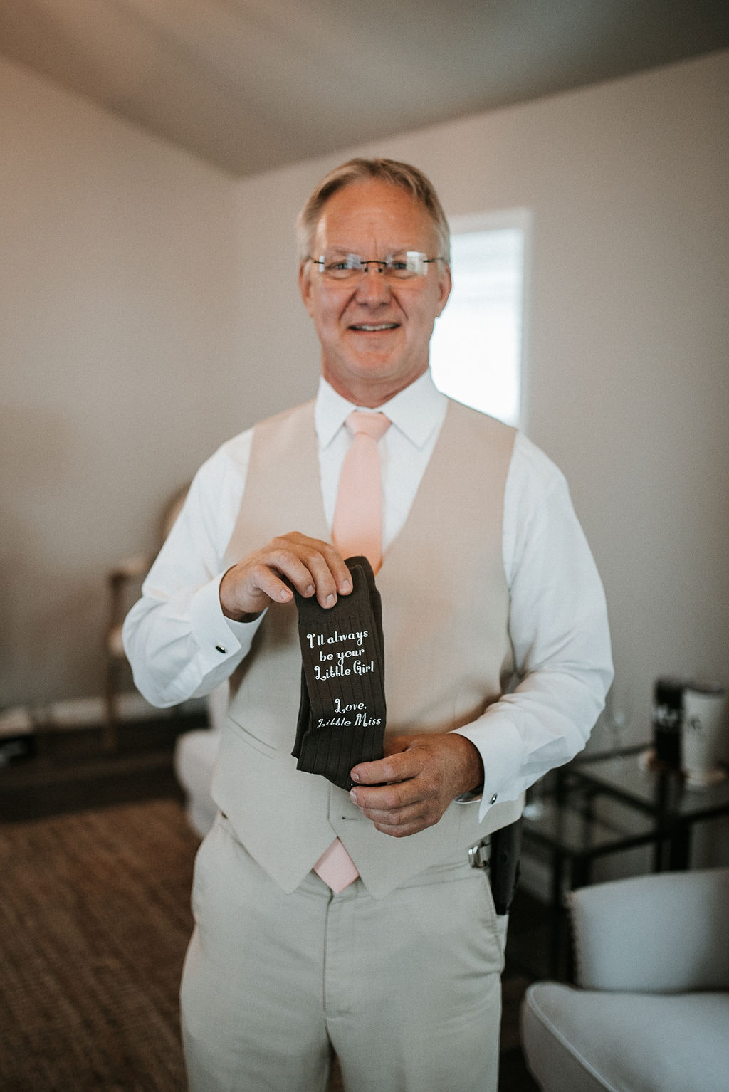 father of the bride holding gift from bride at 48 Fields Farm