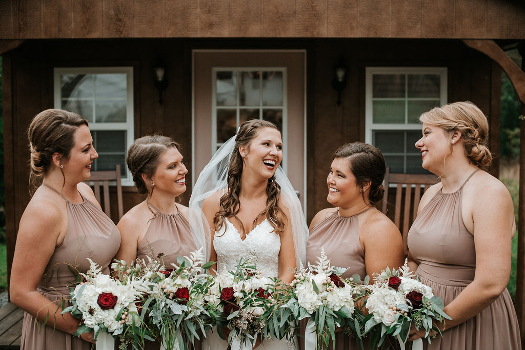 bride and bridesmaids smiling at 48 Fields Farm
