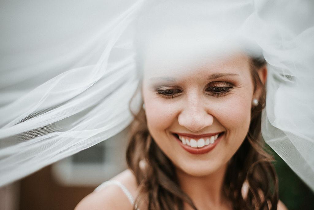 portrait of bride under veil at 48 Fields Farm