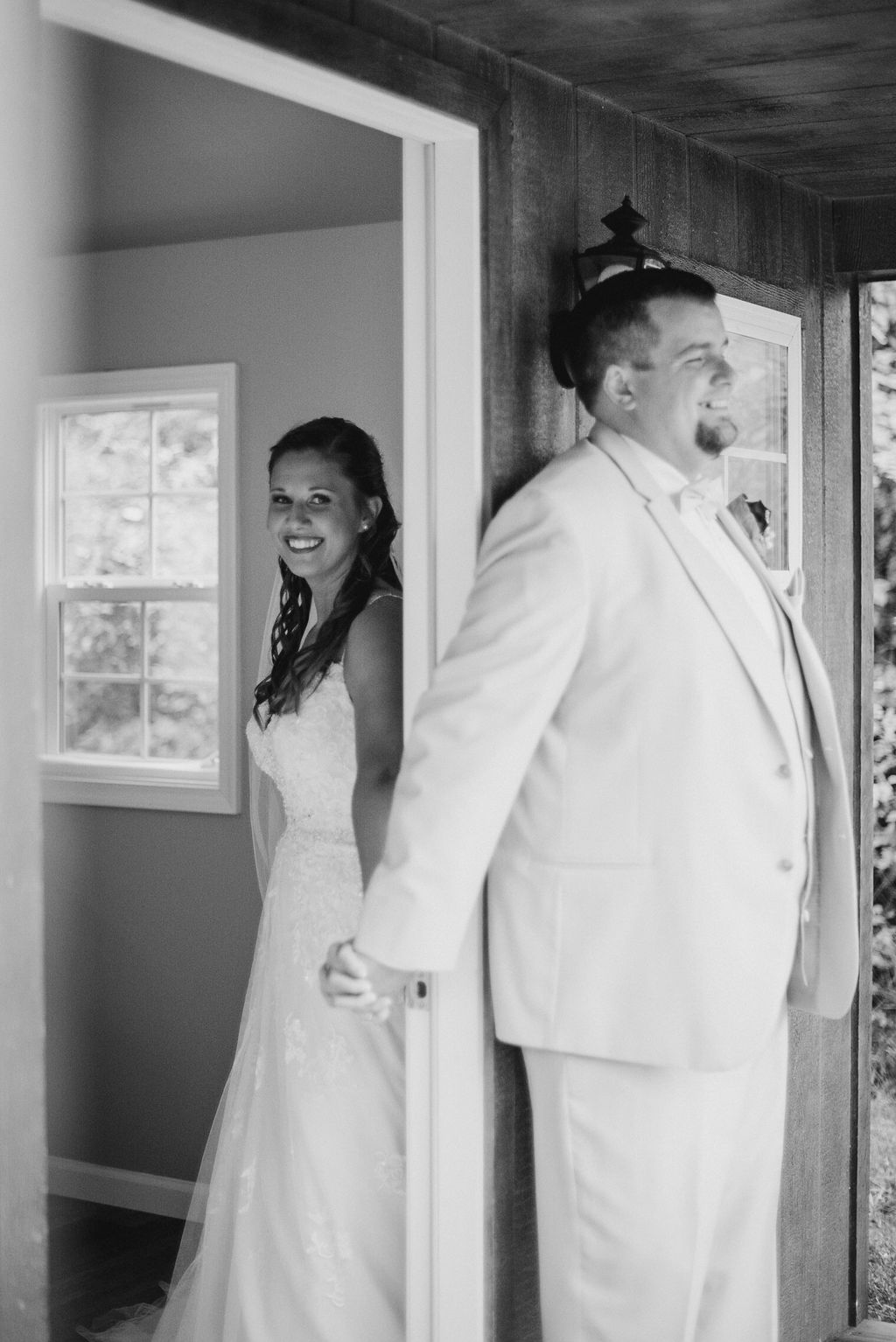 Bride and Groom holding hands in doorway at 48 Fields Farm