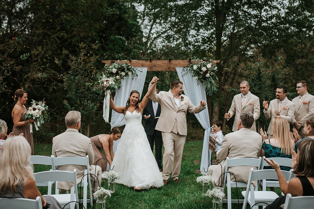 bride and groom cheering after saying I do at 48 Fields Farm