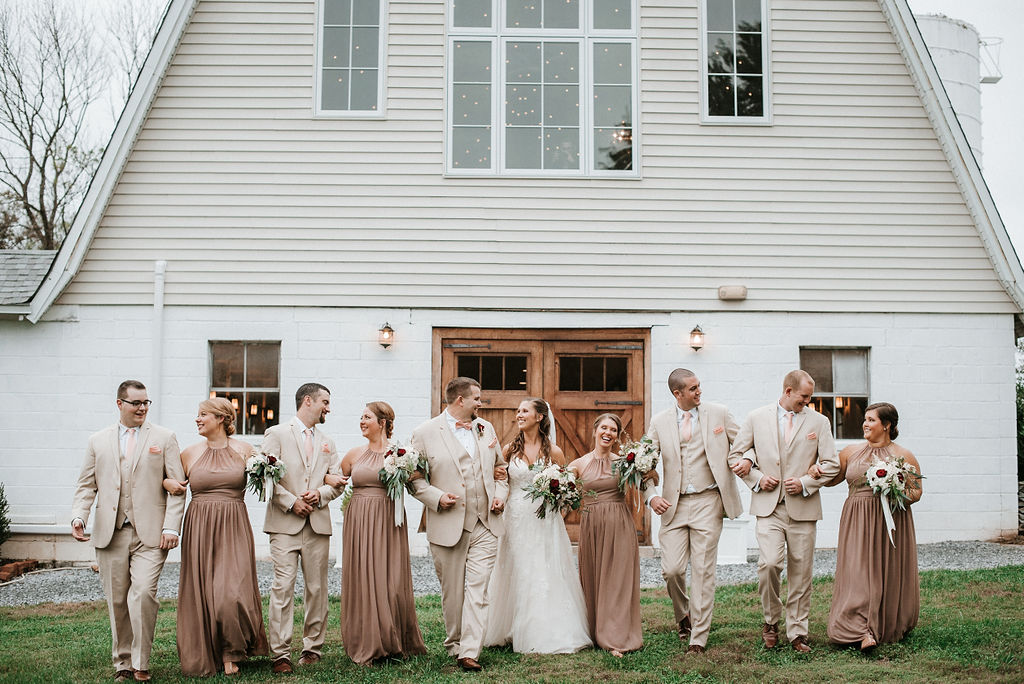 wedding party smiling at 48 Fields Farm