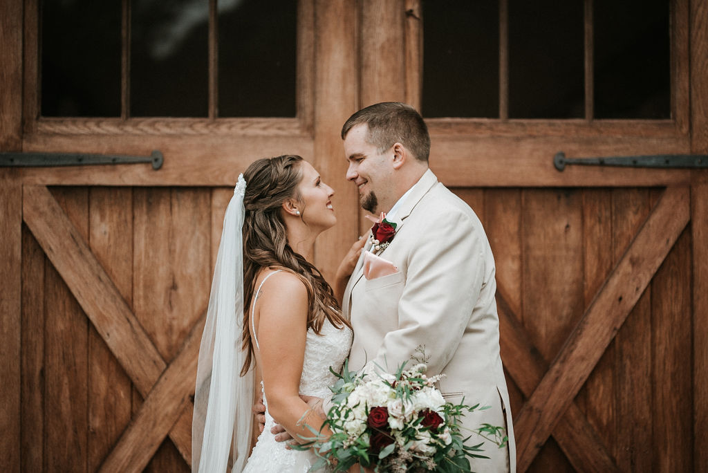 bride and groom looking at each other at 48 Fields Farm