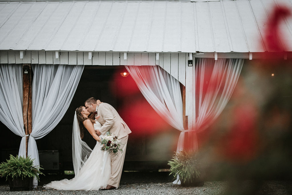 bride and groom kissing at 48 Fields Farm