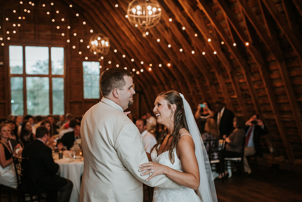 bride and groom having a first dance at 48 Fields Farm