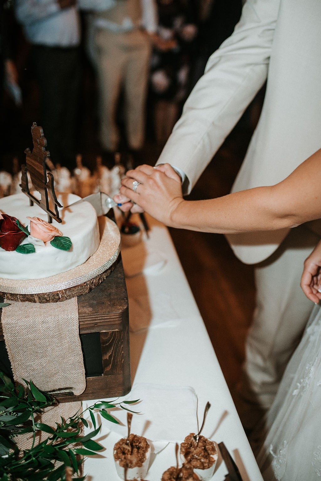 bride and groom cutting the cake at 48 Fields Farm