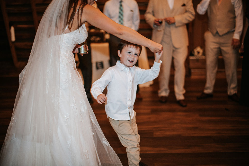 bride dancing with ring bearer at 48 Fields Farm