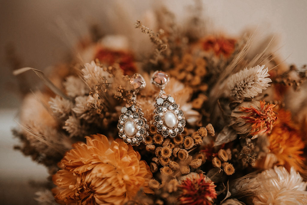 Detail Shots of Earrings and Flowers at Khimaira Farm