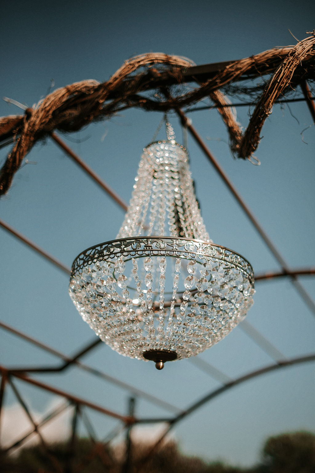 detail shot of chandelier at alter at Khimaira Farm
