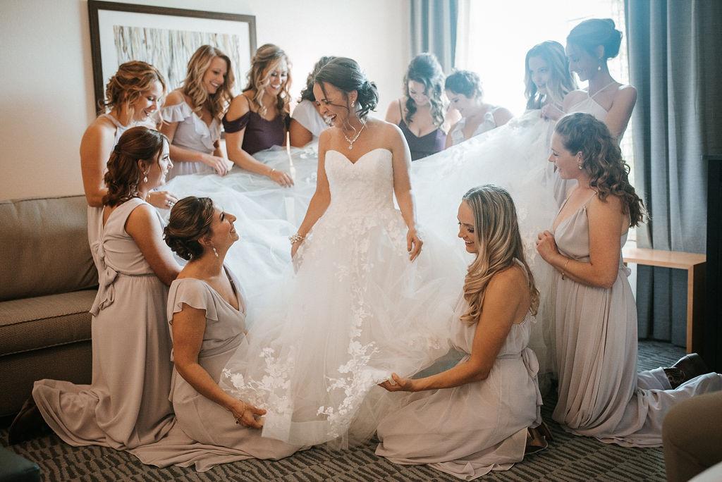 bridesmaids helping bride get ready at kimble farm