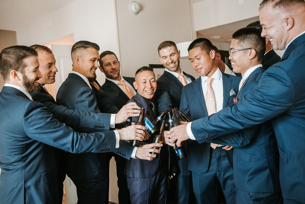 groomsmen and groom having drinks as they get ready at kimble farm