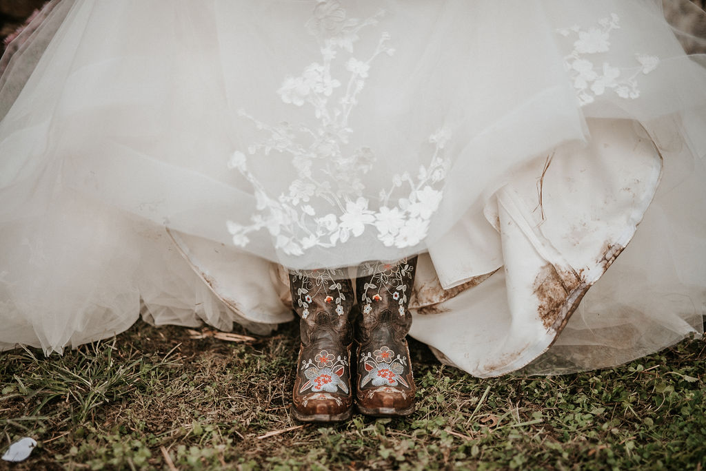cowgirl boots under wedding dress at kimble farm