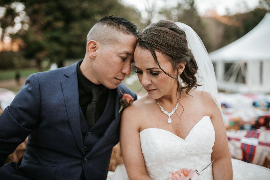 bride and groom posing at kimble farm