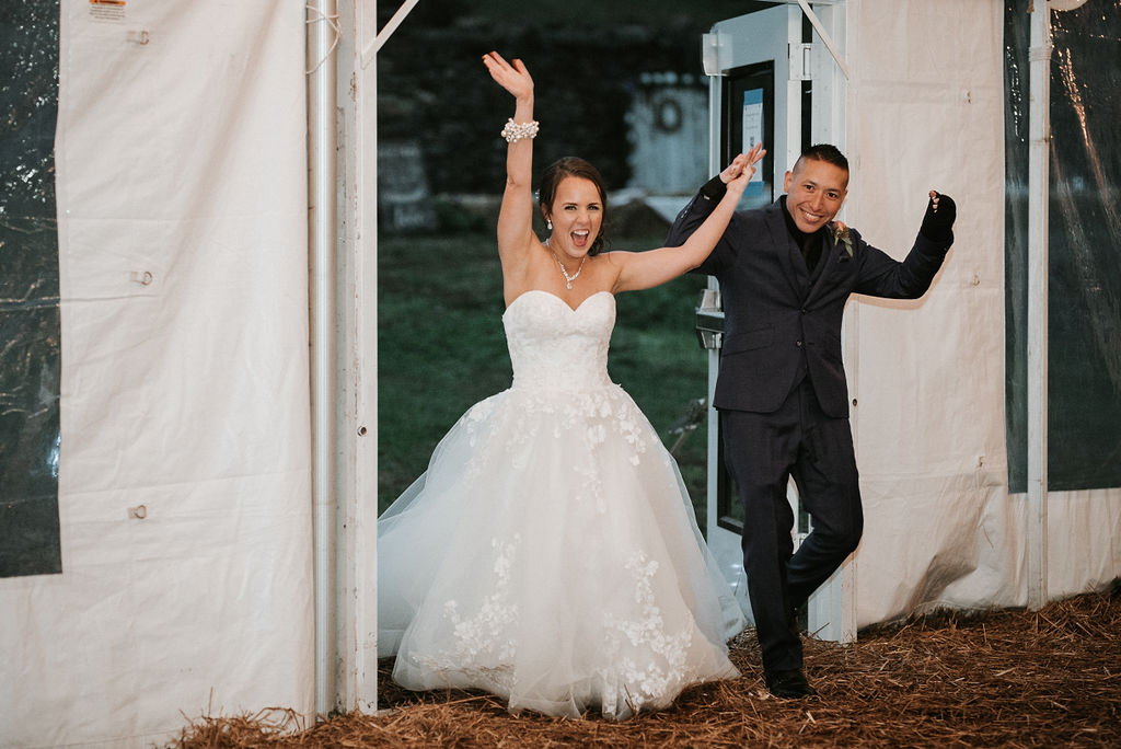 bride and groom entering reception at kimble farm