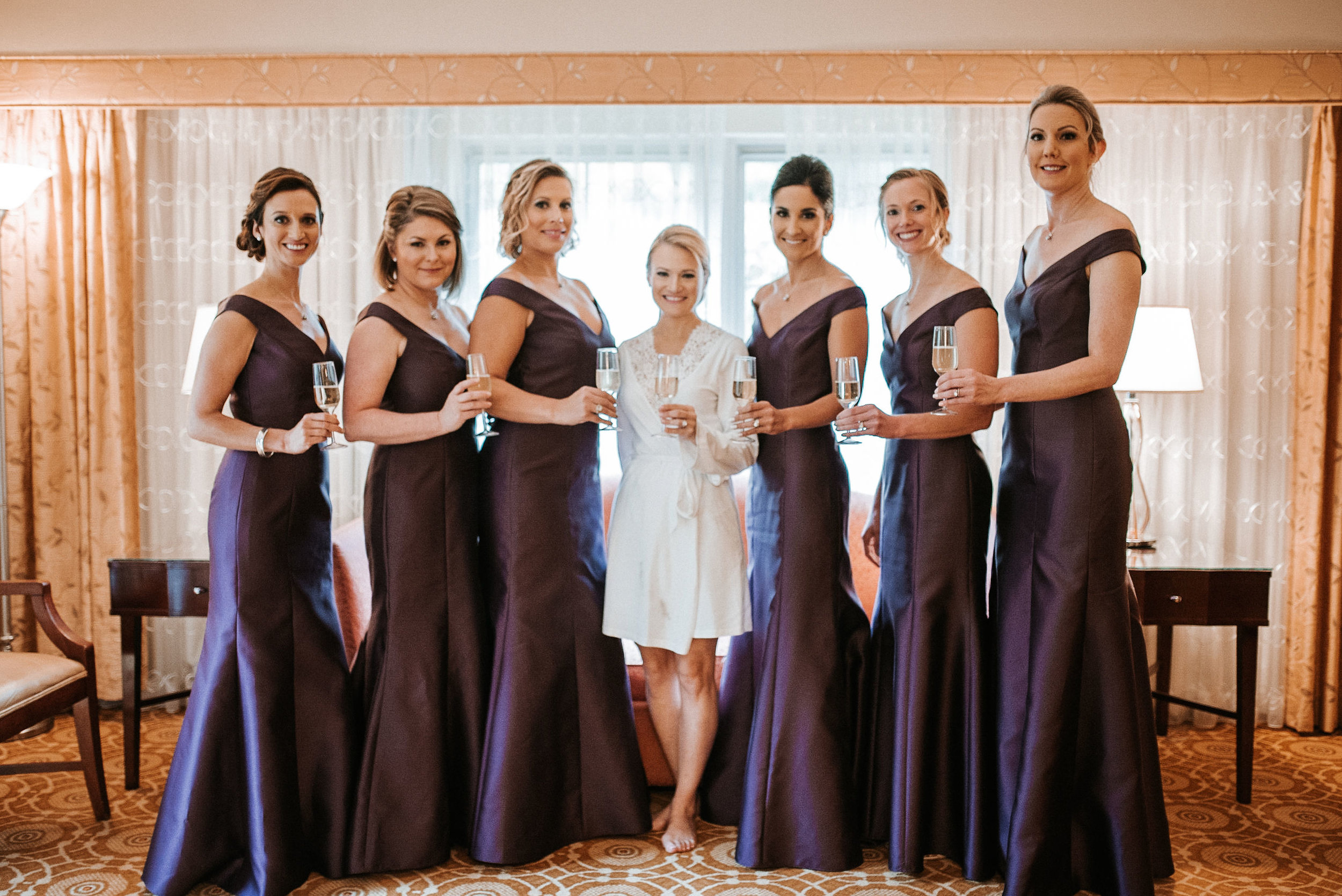 bride and bridesmaids smiling at St. Mark Orthodox Church